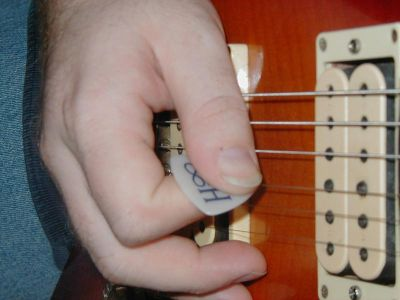 Thumb Muting Technique For Guitar