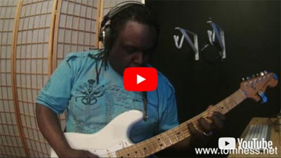 Byron Marks Playing Guitar After Taking Guitar Lessons Online