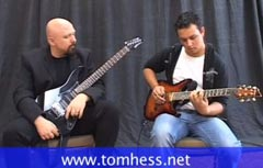 Tom Hess Working With Guitar Student