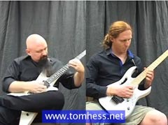 Tom Hess Teaching Sweep Picking To Student