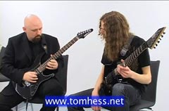 Tom Hess Playing A Guitar Solo With A Student