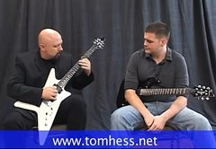 Tom Hess With Guitar Student
