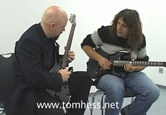 Tom Hess Teaching Guitar To A Student