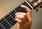 Guitar teacher teachers chords to beginner students